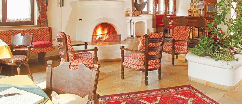 Hotel Alte Post, Ellmau, Austria - lounge with fire place.jpg